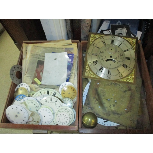296 - A quantity of clock parts to include brass Grand Father clock dials, other clock dials and twelve co...