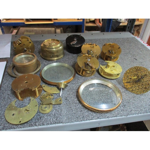 299 - A quantity of clock parts mainly movements two part marine chronometer movements and bowl Location: ...