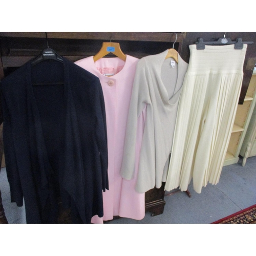 301 - An Armani woollen cardigan and another by Jaeger, a pale pink Antoinette swing coat and a pair of lo...