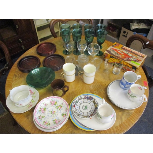 303 - A small quantity of modern household items to include a set of eight green wine glasses, three treen...