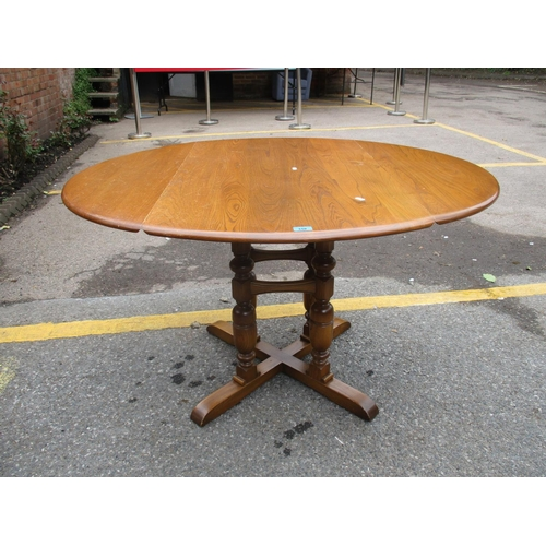 310 - A modern Ercol drop leaf dining table, 73 h x 124 x 113cm d Location: STAIRS...