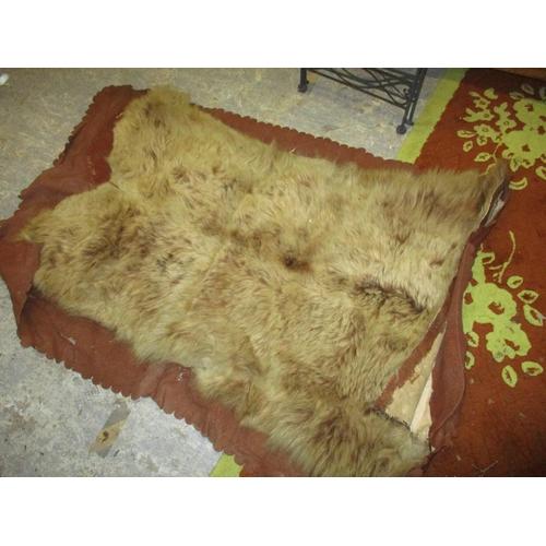 311 - A Victorian brown bear felt backed rug, 142 x 106cm Location: G...