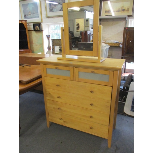 312 - A contemporary pine chest of two short and four long drawers together with a matched dressing table ...