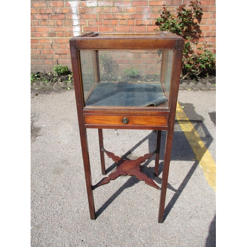 320 - An early 19th century mahogany bijouterie cabinet, with lift-off top above single drawer, raised on ...