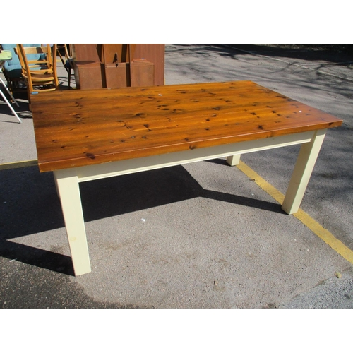 324 - A modern dining table with stained pine top, raised on cream painted legs 79cm h x 180cm w x 99cm d ...