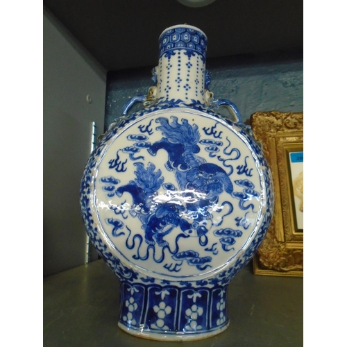 317 - !!! THIS LOT HAS BEEN WITHDRAWN !!!  A late 19th century Chinese blue and white moon flask with twin...