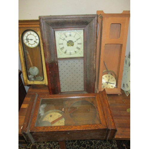 326 - Clock parts to include regulator style cases, a Magneta electric clock movement, and other items  Lo...