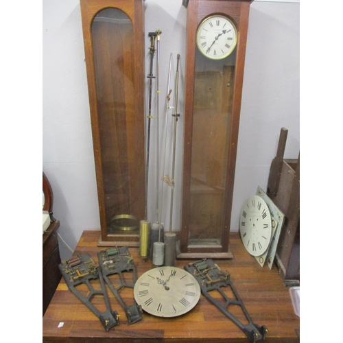 328 - Synchronome electric clock parts to include two cases, three movements, four pendulums and a dial  L...
