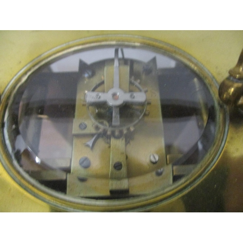 329 - An early 20th century brass cased carriage clock the dial indistinctly inscribed 16cm high including...