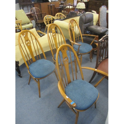 314 - A set of four modern Ercol dining chairs with carved swan backrests to include two carvers Location:...