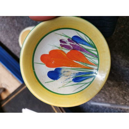 103 - A Clarice Cliff Windsor shape teapot in the Autumn Crocus pattern, together with a small collection ...