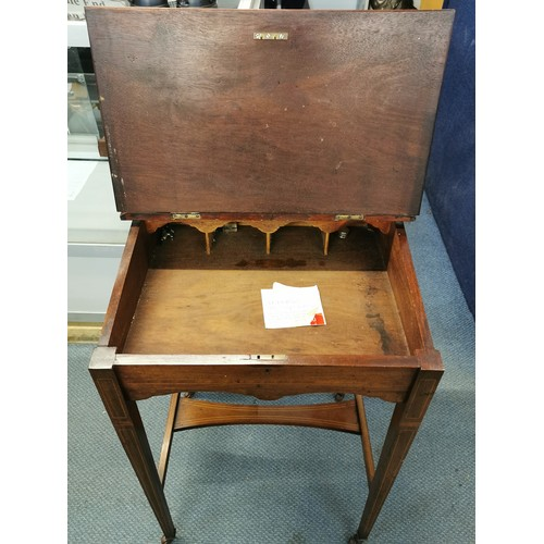 10 - An Edwardian mahogany bonheur du jour, with bevelled mirror back, string inlay and tooled leather to...