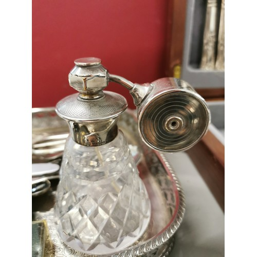 35 - A sterling silver mounted glass atomiser, together with a cased canteen of silver plated cutlery for...