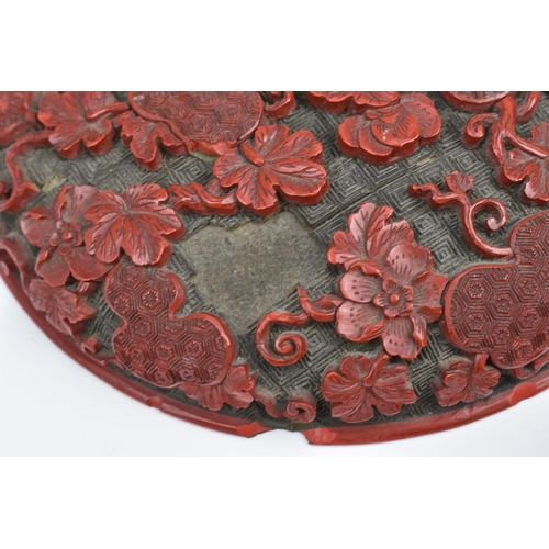 1 - A Chinese Qing dynasty carved cinnabar lacquer box, of circular form, with intricately detailed foli...