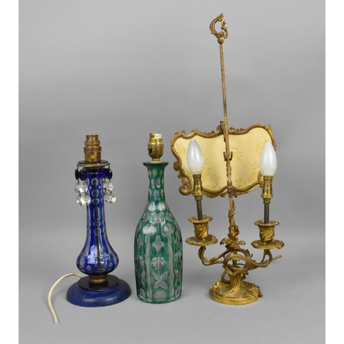 110 - A French 19th century ormolu bouillotte lamp, with converted twin light held on an acanthus scroll b...