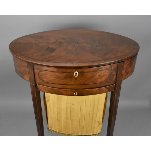 114 - A Georgian mahogany ladies sewing table, of oval shape with string inlay, lift up top with ivory inl...