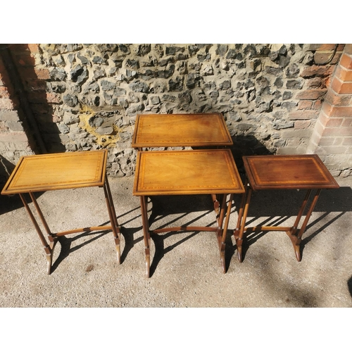 124 - A nest of Edwardian mahogany quartetto tables, in the Regency style, comprising four graduated table...