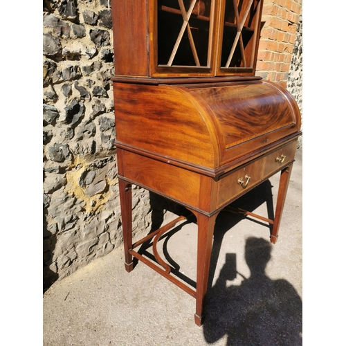 125 - An Edwardian string inlaid mahogany veneer bureau bookcase by Maple & Co, the glazed astragal vitrin...