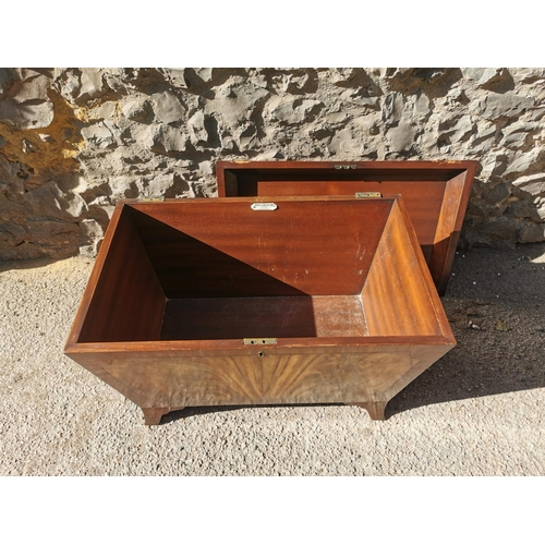 129 - A regency style mahogany wine cooler, of sarcophagus shape, on spayed feet, the inside with Thomas C...