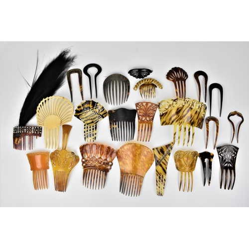 168 - A collection of early 20th century faux and real tortoiseshell hair combs, comprising mantilla combs...