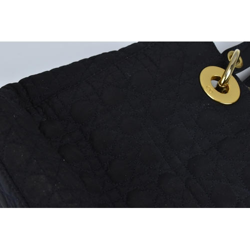 173 - A circa 1990's Christian Dior Lady Dior MM bag in Cannage quilted navy fabric with gold tone hardwar...