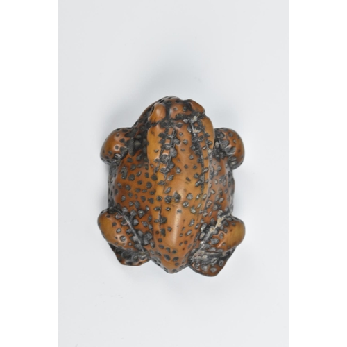 23 - A Japanese wooden carved netsuke modelled as a crouching toad, Edo period, signed to the underside R...