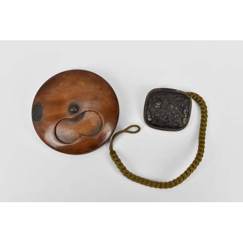 26 - A Japanese pressed horn Manju, 19th century, of rectangular form with carved samurai and tiger to on...