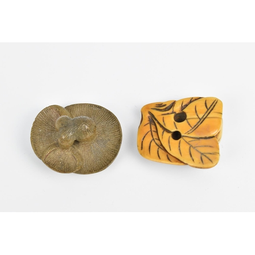 32 - A Japanese carved ivory netsuke, 19th century, modelled as a mouse on a leaf with fruit, unsigned, 4...