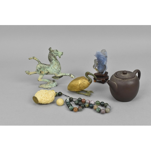37 - A small collection of Chinese works of art to include a red clay miniature teapot, a carved snuff bo...