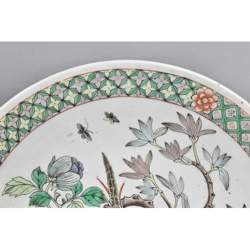 40 - A Chinese late Qing dynasty famille verte charger, decorated with green, yellow and iron enamels dep...