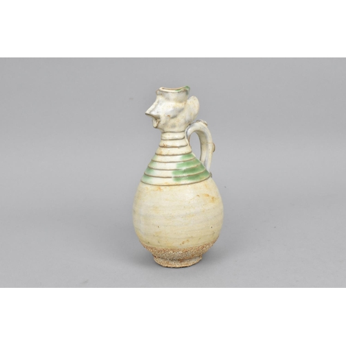 42 - A Chinese Qingbai glazed pottery ewer of ovoid shape  with phoenix head and turned detail to the nec...