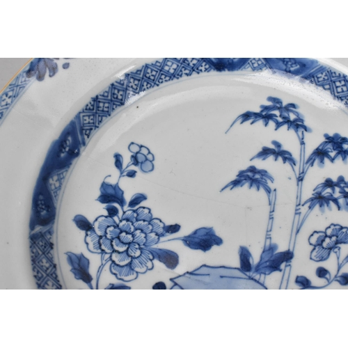 43 - An 18th century Chinese blue and white Kangxi style plate with central hunting scene and meandering ...