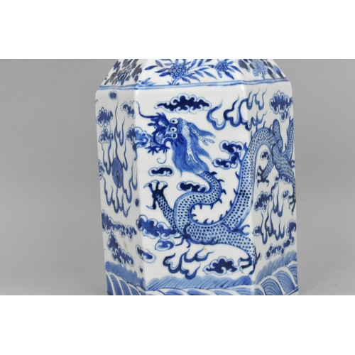44 - A Chinese late Qing dynasty blue and white porcelain lamp, of hexagonal shape with four clawed drago...