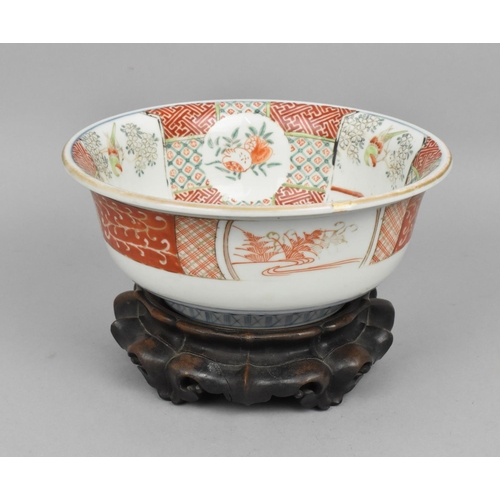 45 - A 19th century Chinese famille verte bowl on hardwood stand, the bowl with slight everted rim decora...