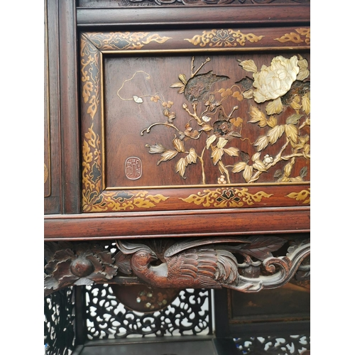 47 - A Japanese Meiji period Shibayama inlaid and lacquer display cabinet, with finely carved ivory, moth...