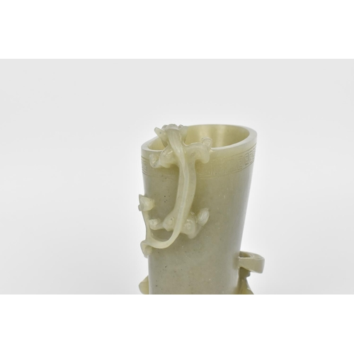 10 - A Chinese 20th century carved celadon jade libation cup, modelled with a kylin and water buffalo, th...