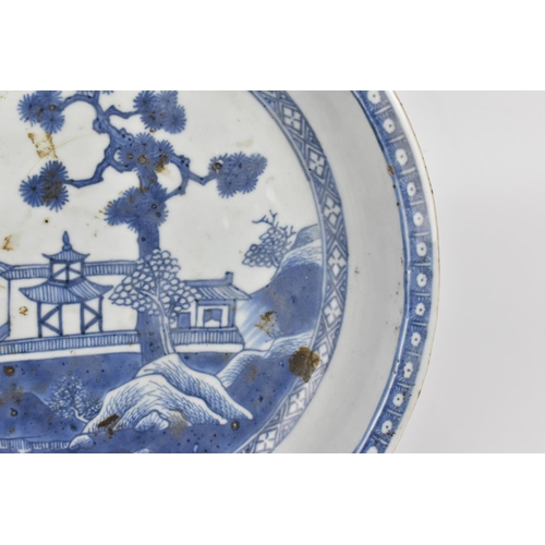 15 - A Chinese Qing dynasty blue and white porcelain meat dish, possibly Qianlong period or later, of ova...
