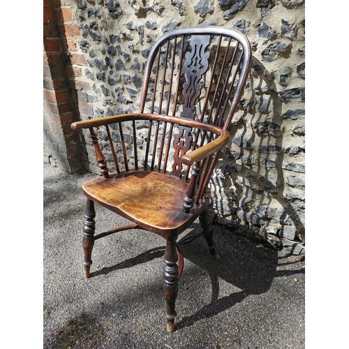 156 - A 19th century ash windsor chair with comb back, pierced splat, supported on turned legs with crinol...