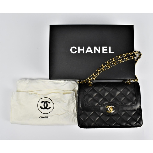 162 - A Chanel, pre 1984, black lambskin double flap handbag with gold tone hardware to the shoulder strap...