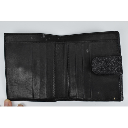 163 - A Chanel black 'caviar' leather bi-fold purse wallet lined with calfskin and more silk, stamped Made...