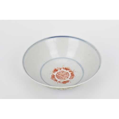 17 - A Chinese Famille Jaune porcelain bowl, with applied polychrome enamel chrysanthemums and other flow...