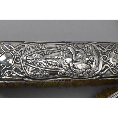 191 - A small miscellaneous group of silver, comprising two Art Nouveau silver mounted brushes, by differe...