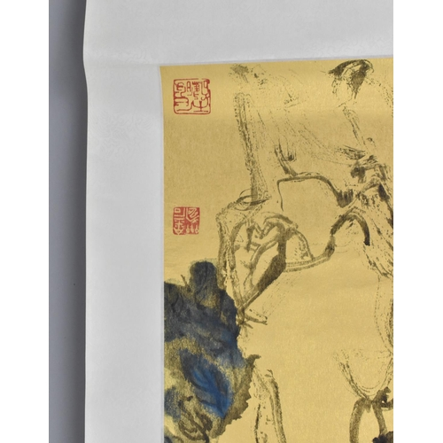58 - A large Chinese scroll painting on paper, laid on silk, depicting blooming red flowers and foliage o...