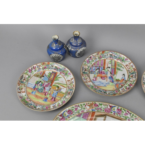 59 - A set of four 19th century Cantonese porcelain plates and two oval dishes, each decorated with a cen...