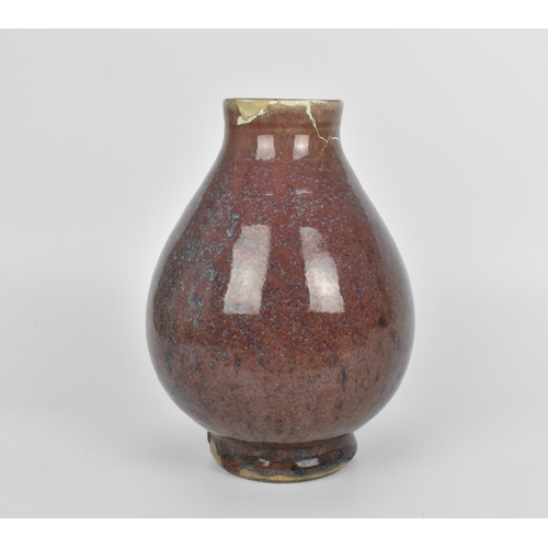 6 - A Chinese flambe glazed vase, 18th century or earlier, with bulbous body on a short circular base, t...