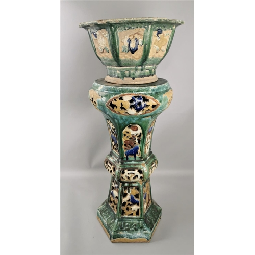 63 - A 19th century Chinese sancai glazed jardiniere on stand, the jardiniere with octagonal top above a ...