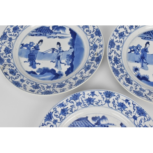7 - Three Chinese Kangxi blue and white porcelain plates, of circular form with central scene depicting ...