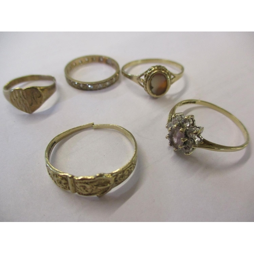 2 - A group of five 9ct gold dress rings stamped 375 to include a full eternity ring with white sapphire...