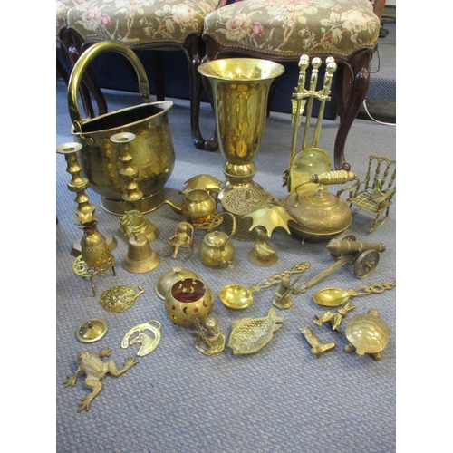 22 - Mixed 20th century brass household fireside and ornamental items to include a model cannon, a coal b...