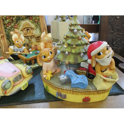 23 - A quantity of PenDelfin models of rabbit characters to include a musical Christmas display, a framed...